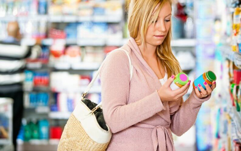 woman holding jar in the supermarket