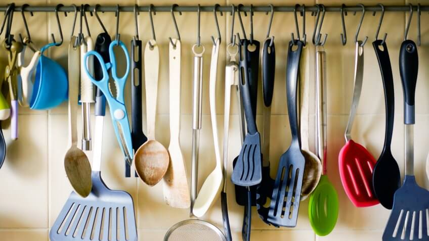 kitchen tools hanging from hooks
