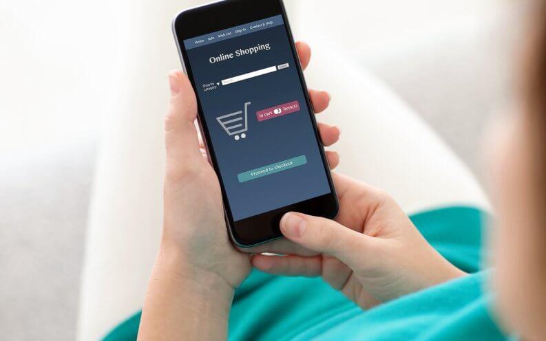 woman shopping online through her phone
