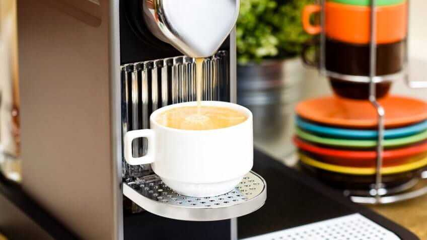 Espresso machine pouring coffee into a coffee cup