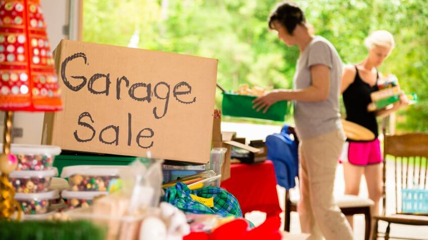 Adult women shopping at a garage sale in suburbs