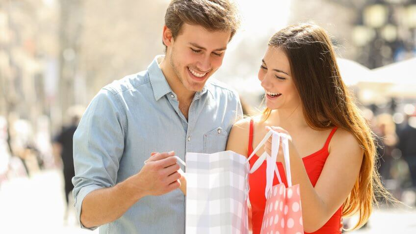 Couple shopping and looking into shopping bag