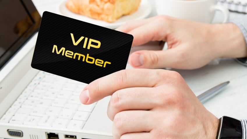 person holding vip member card