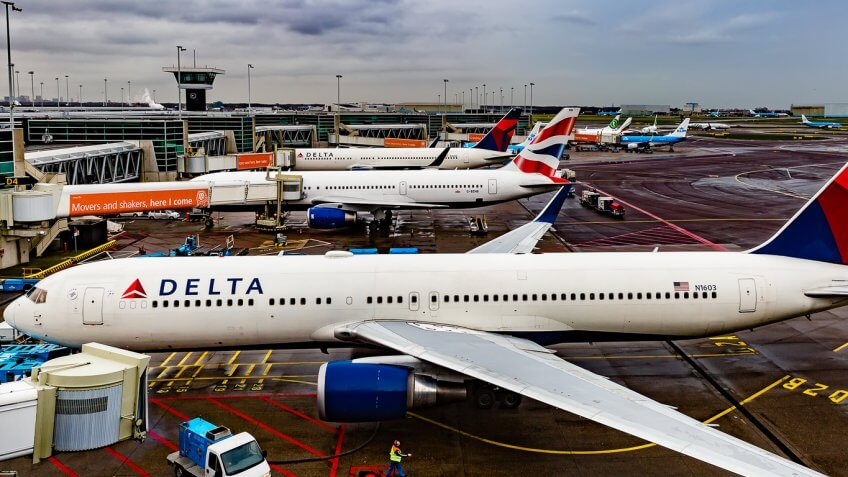 Fleet of Delta airplanes parked at different terminals