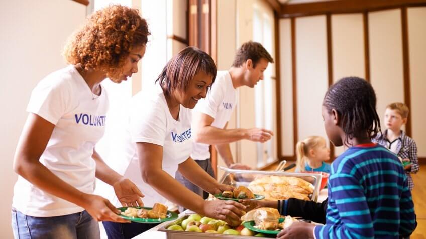 group of volunteer workers serving food