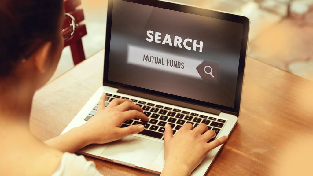 woman using a search engine to look up mutual funds