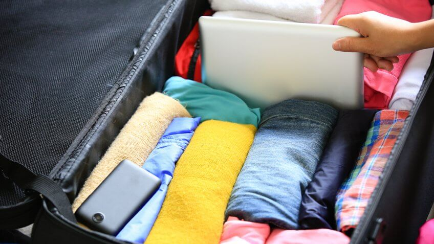 Suitcase packed with clothes