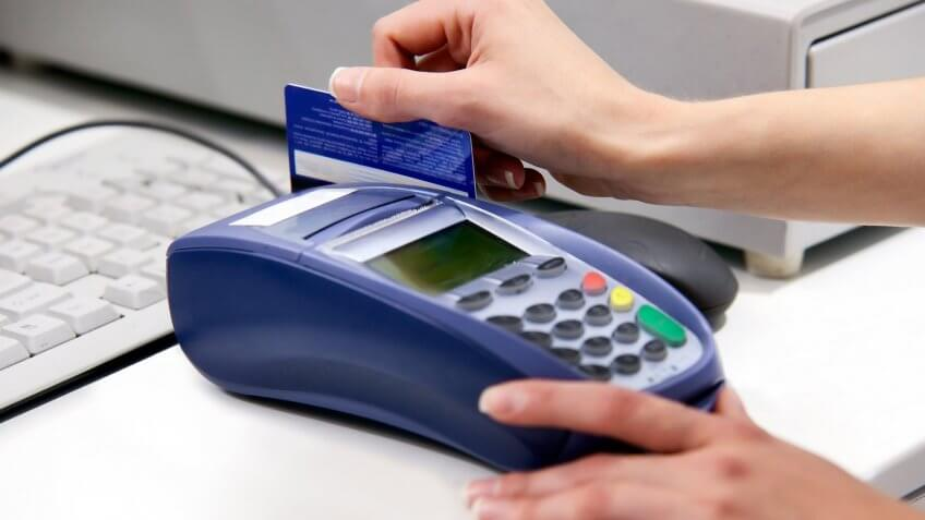 hand swiping credit card payment