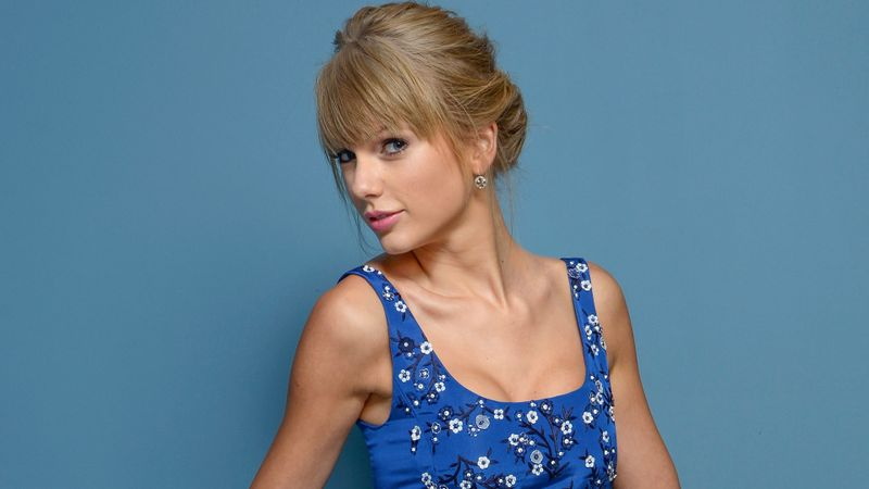 TORONTO, ON - SEPTEMBER 09:  Actress Taylor Swift of 'One Chance' poses at the Guess Portrait Studio during 2013 Toronto International Film Festival on September 9, 2013 in Toronto, Canada.