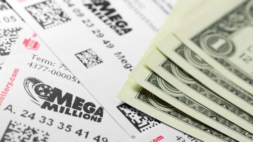 Philadelphia, United States - March 13, 2011: Many Mega Millions lottery tickets and one dollar bills.
