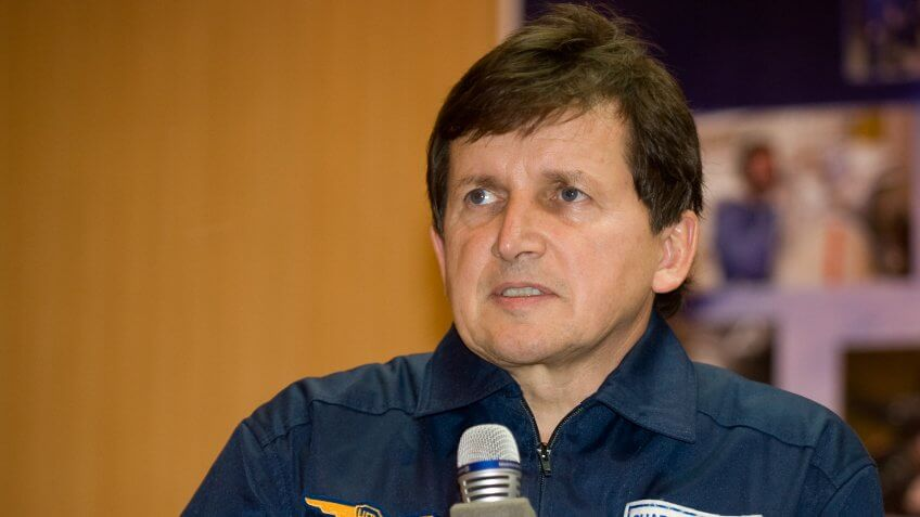 Spaceflight Participant Charles Simonyi answers questions from behind glass during a press conference on Wednesday, March 25, 2009 at the Cosmonaut Hotel in Baikonur, Kazakhstan.
