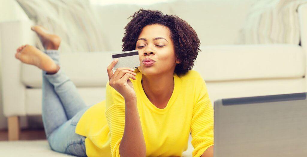 woman blowing kiss at credit card