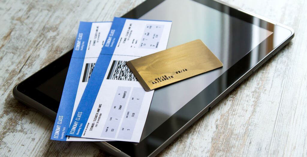 credit card, two plane tickets, and a tablet