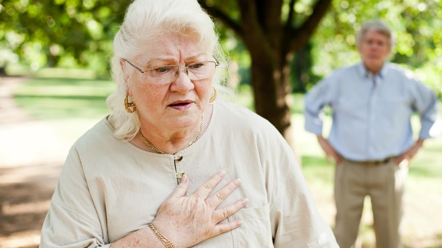 A senior woman experiencing chest pain.