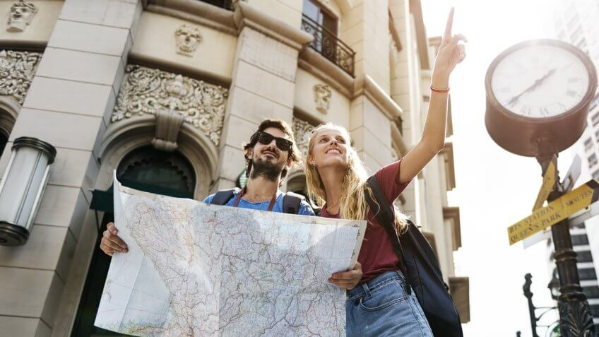 young tourist couple holding a map