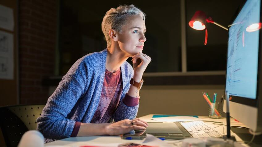 10 Best and Worst Industries for Work-Life Balance, 30-34 years, Alberta, Business, Businesswoman, Calgary, Canada, Candid, Casual, Caucasian, Computer, Concentration, Creativity, Dark, Dedication, Desk, E-Mail, Graphic Designer, Hand On Chin, Internet, Lamp, Leaning, Night, Occupation, Office, One Person, Real People, Skill, Technology, Working, access, after hours, blonde hair, color image, connection, copy space, creative, deadline, designer, drawing, drawing tablet, emailing, focusing, horizontal, illumination, indoors, late shift, mid adult, mid adult women, online, overtime, people, photography, planning, project, serious, short hair, sitting, using, waist up, woman, working late