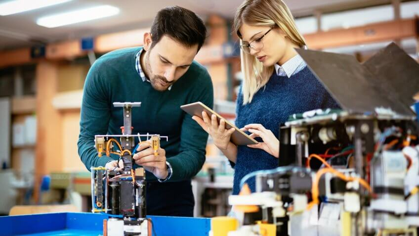 10 Best and Worst Industries for Work-Life Balance, Robotics engineer students teamwork on project