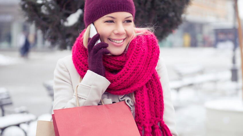 woman in the snow on the phone