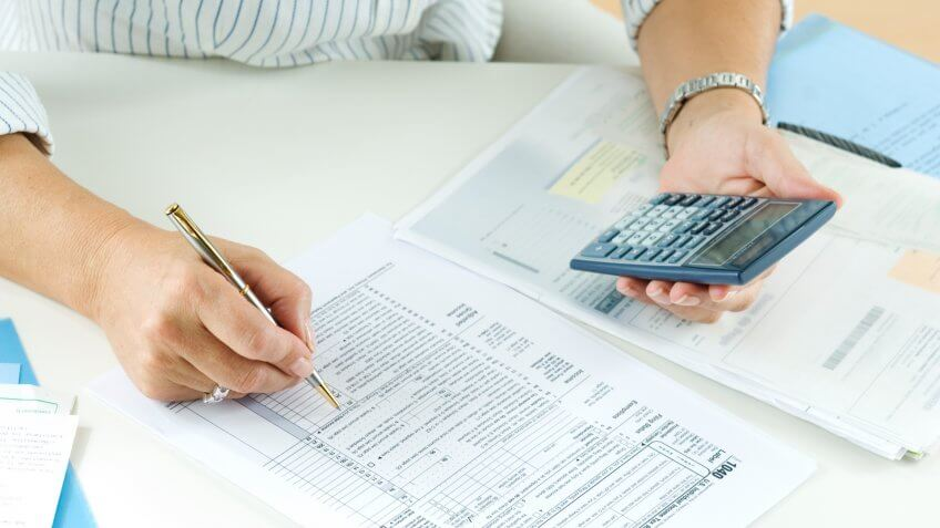 Woman calculating her taxes.