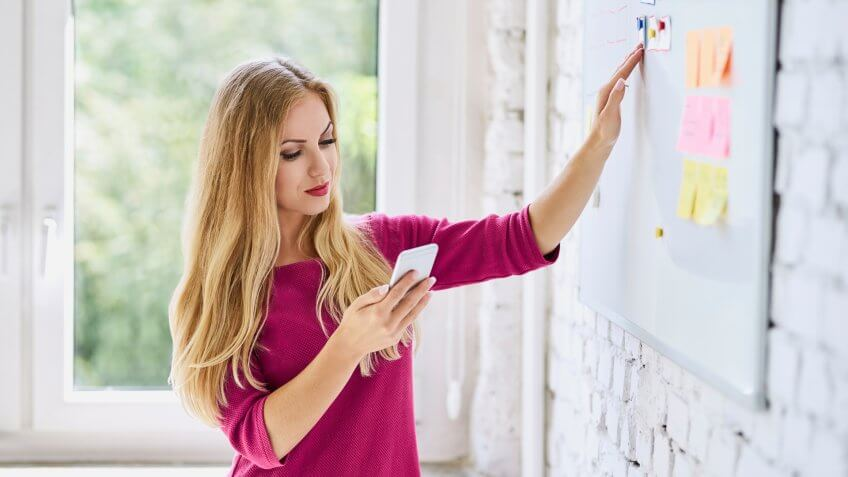 10 Best and Worst Industries for Work-Life Balance, Developing mobile application. Young woman designing start-up we