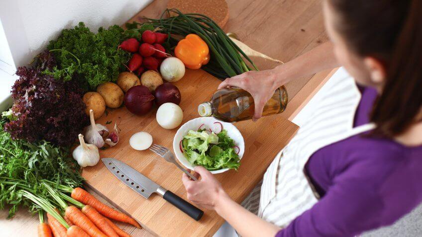 woman making a veggie salad