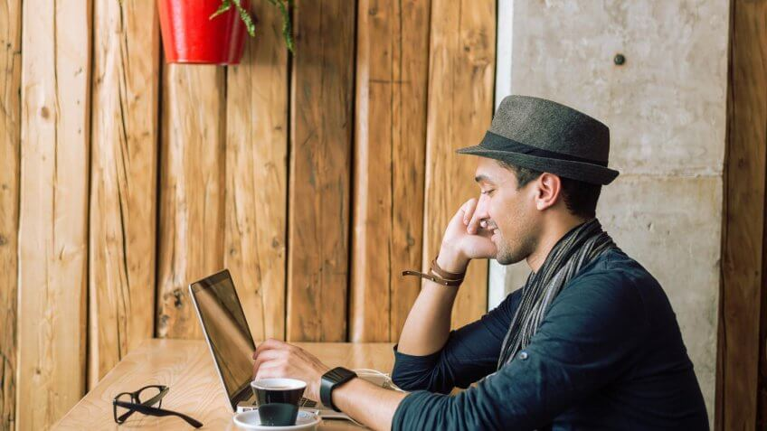 man at coffee shop with laptop