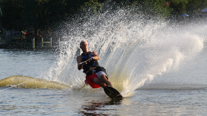 Annapolis, Maryland, USA- July 26, 2010: Mature Man Slalom Water Skiing on a tributary of the Chesapeake Bay in Annapolis, Maryland, USA.