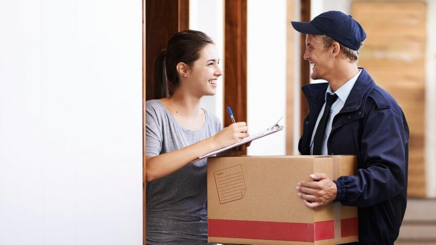 woman accepting a package delivery