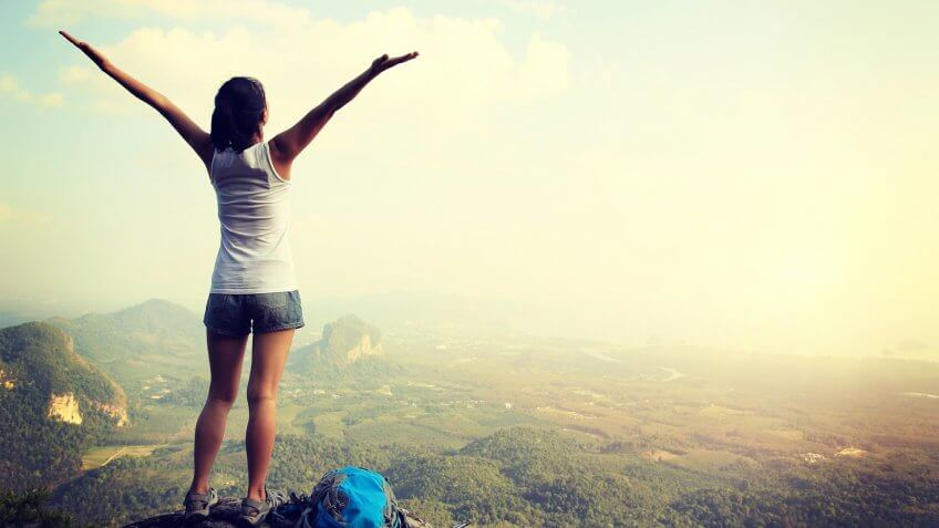 girl at the top of a mountain