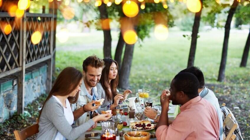 group of friends having dinner outside