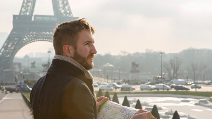 young man traveling in Paris