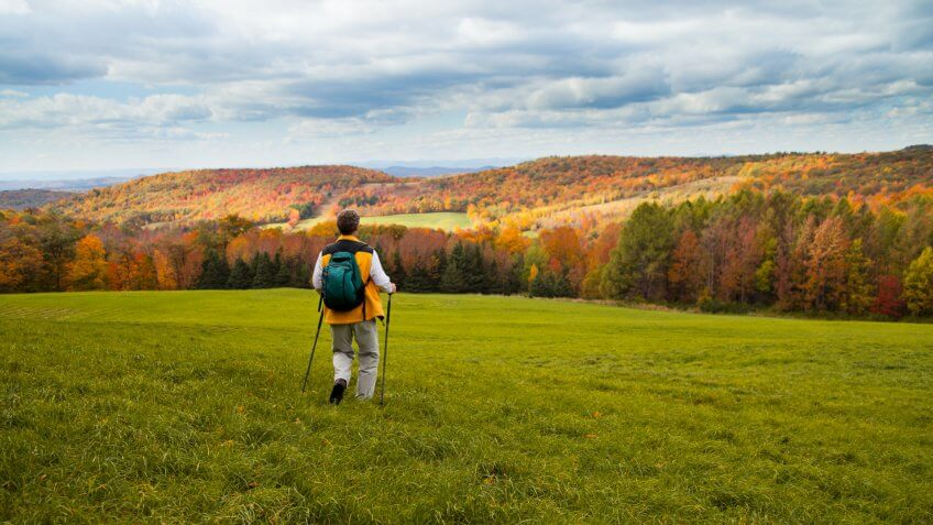 Senior man hiking in Autumn setting.
