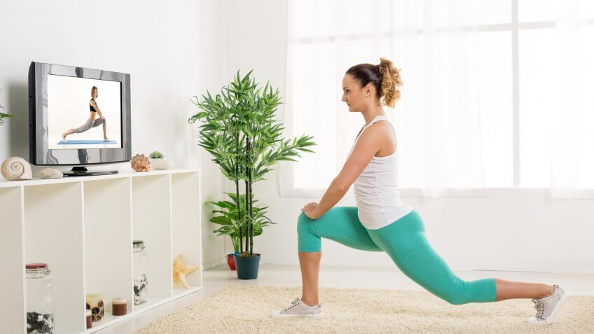 girl practicing yoga in house