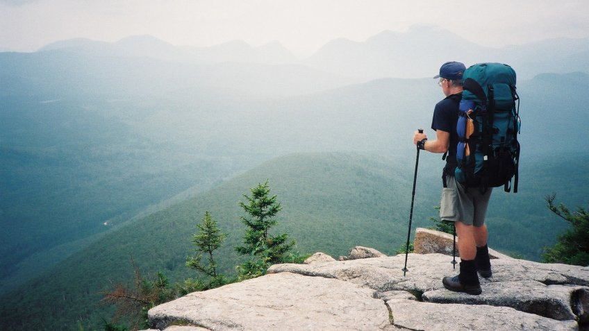 A backpacker views mountains to be travelled in New Hampshire on his 3500 km.