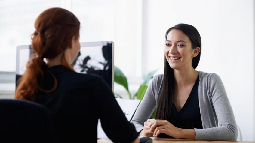 female employee talking to boss