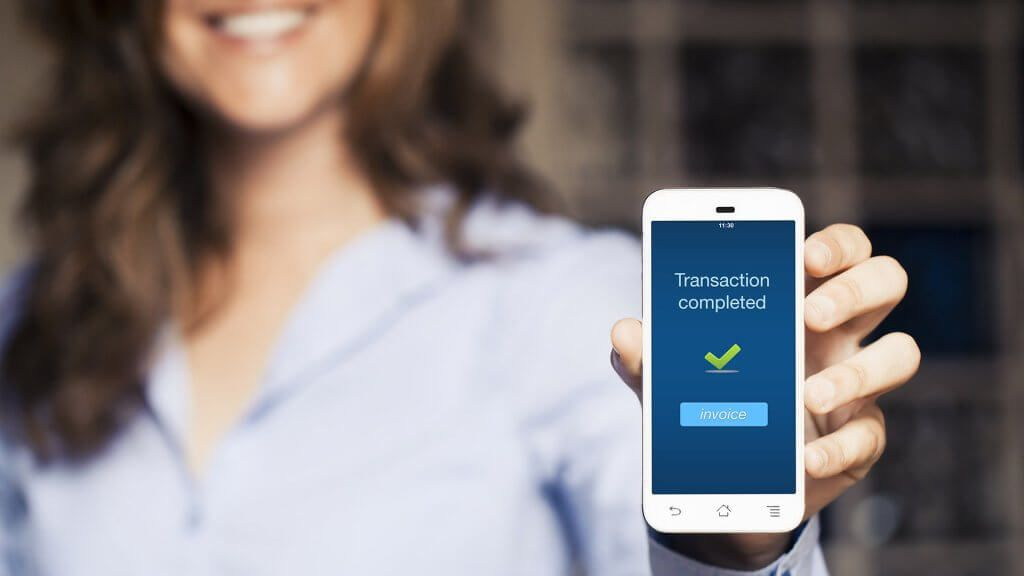 woman showing a completed bank transaction notice on her phone