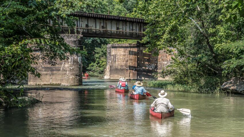 A group canoeing down the Cahaba River in Helena, Alabama in the Summer.