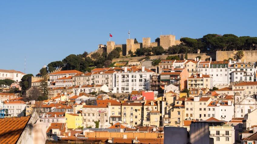 Sao Jorge Castle in Lisbon, with surrounding architecture.