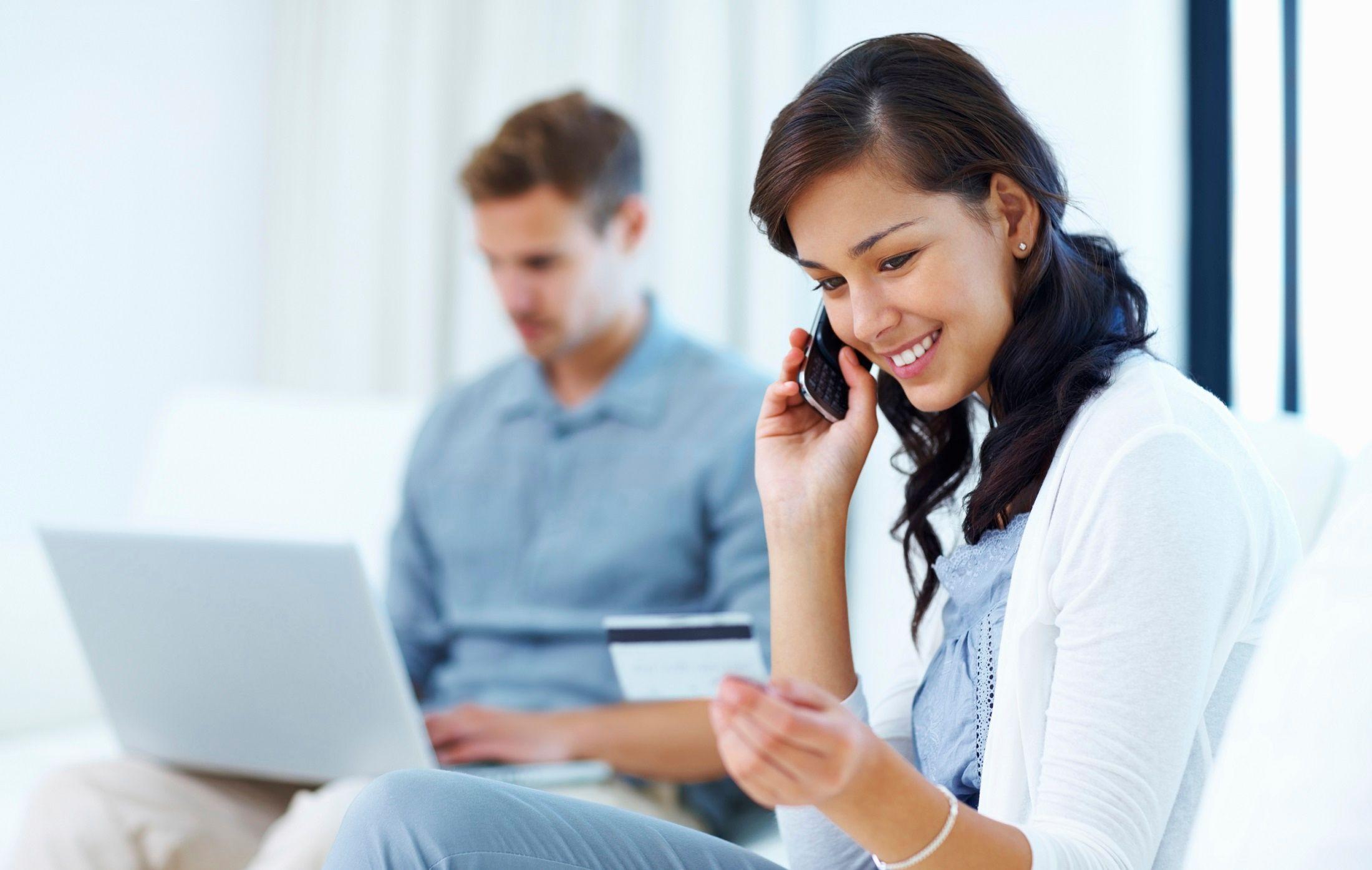 woman on phone credit card bills
