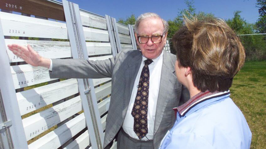 Warren Buffett down on the farm, Benjamin Moore's test farm that is, in Flanders, N.