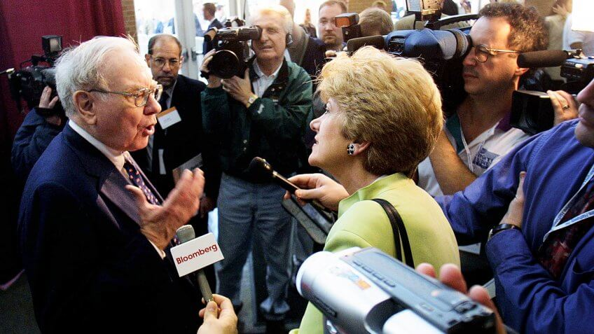 404925 01: Warren Buffett of Berkshire Hathaway talks to members of the media May 4, 2002 at the annual Berkshire Hathaway shareholders meeting in Omaha, Nebraska.