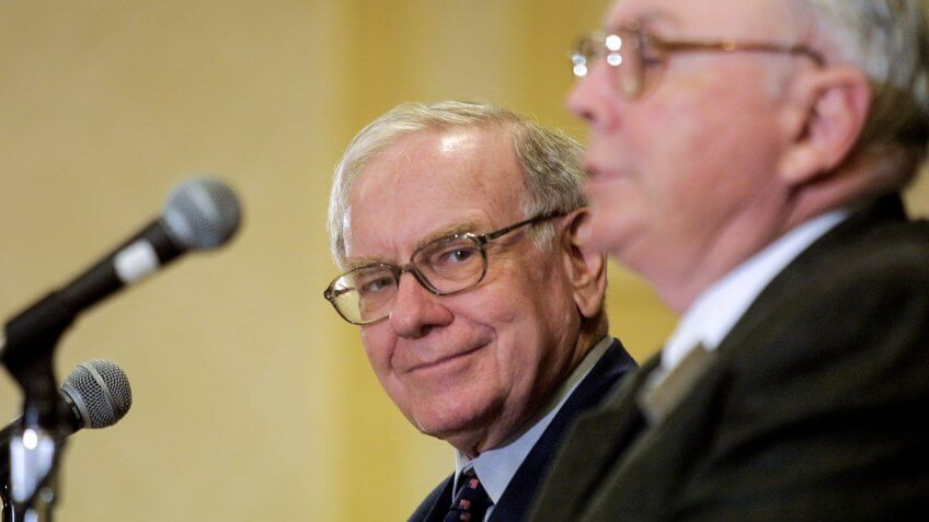 404962 01: Warren Buffett (L) and Berkshire-Hathaway partner Charlie Munger address members of the media May 5, 2002 in Omaha, Nebraska following the annual shareholders meeting.