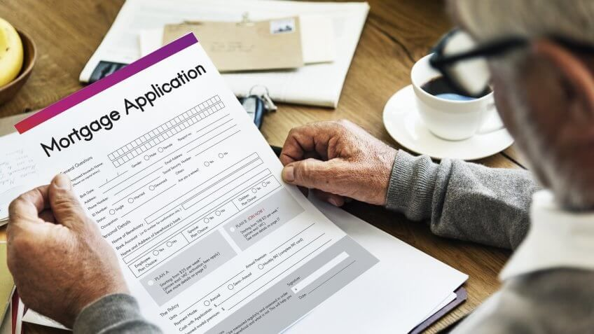close up of man holding mortgage application