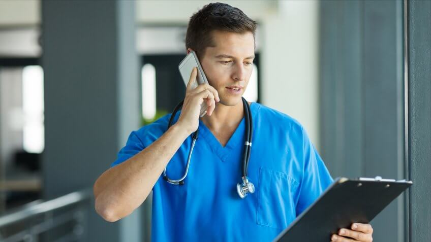 professional medical doctor talking on mobile phone in hospital.