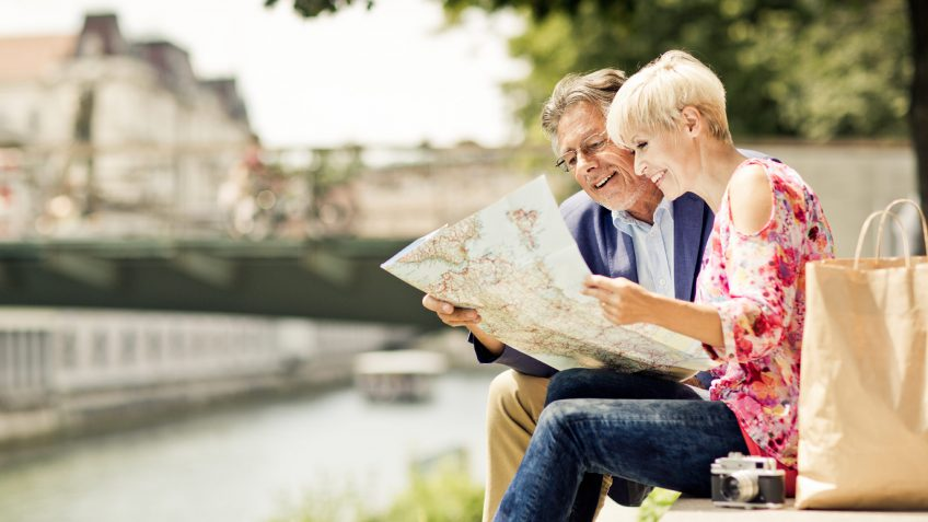 older couple looking at a map