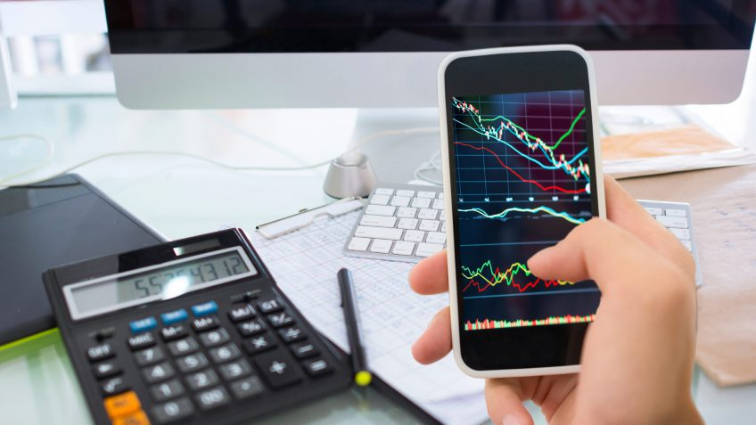using a smartphone to check the stock market