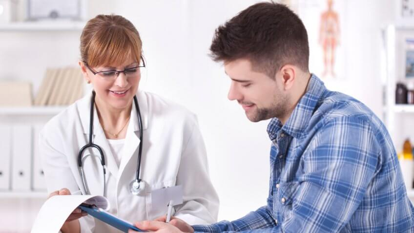 young man speaking to a female doctor