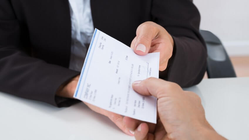 close up of person receiving a check