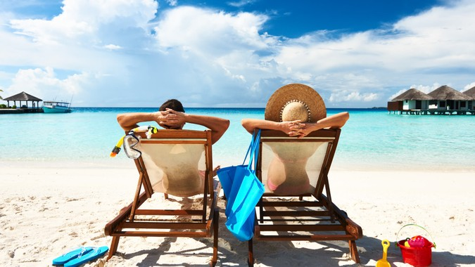 Couple on a tropical beach at Maldives.