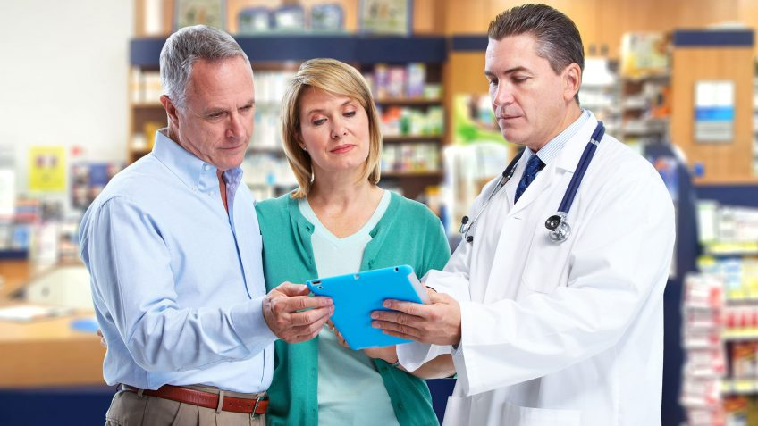 couple speaking to a pharmacist